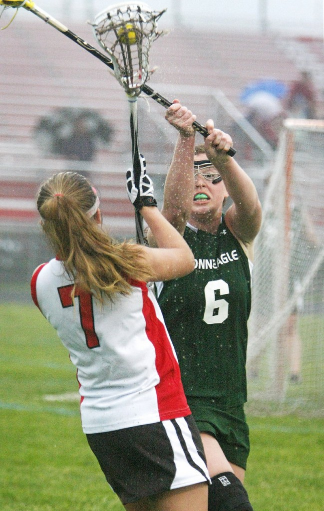 Riley Heroux of Bonny Eagle attempts to block a shot by Lani Edwards of South Portland in the second half.