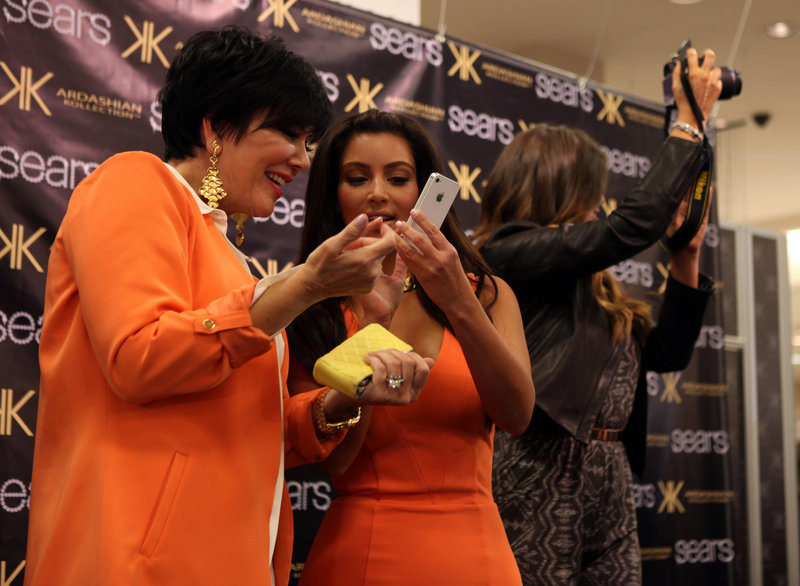 Kris Jenner and her daughters Kim and Khloe Kardashian greet customers as the three promote the Kardashian Kollection at a redesigned Sears store at Woodfield Mall in Schaumburg, Ill.