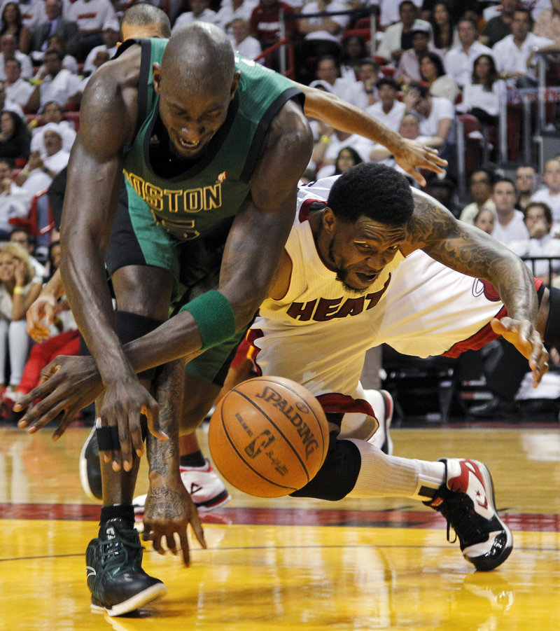 Kevin Garnett of the Boston Celtics, left, and Udonis Haslem of the Miami Heat compete for a loose ball Wednesday night during the Heat's 115-111 overtime victory.