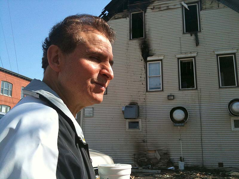 In this April 20, 2012 file photo, Gorham House of Pizza owner Angelo Sotiropoulos at the scene of a fire that heavily damaged his business. Investigators have determined that an electrical problem was the cause.