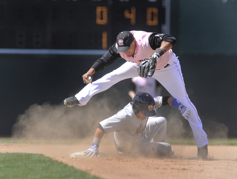 Juan Centeno of the Binghamton Mets slides into second base Saturday, disrupting Ryan Dent of the Portland Sea Dogs and breaking up a potential double play.