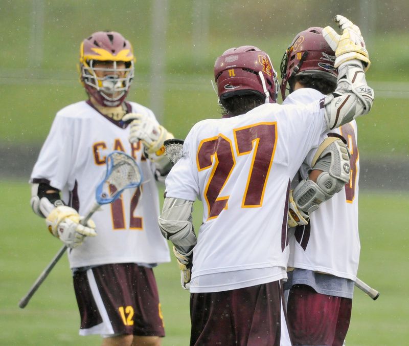 Justin Cary, 27, who scored five goals, celebrates with Tim Lavallee, left, and Brian Brett after a first-half Cape goal.