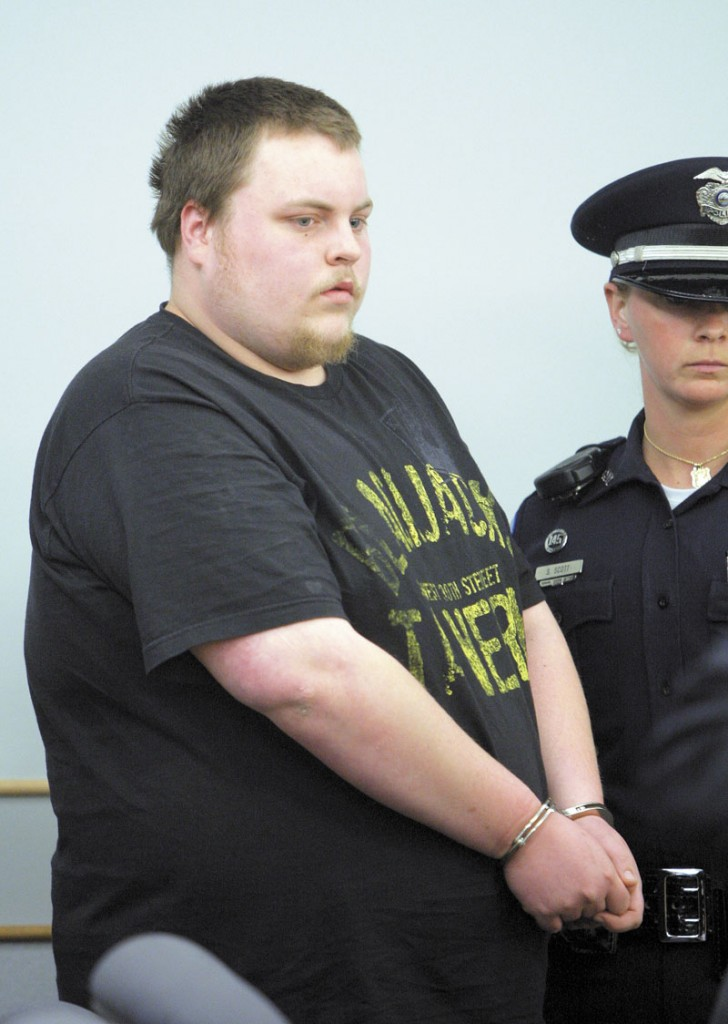 Trevor Ferguson, 23, is led in to Ossipee District Court in Ossipee, N.H. in May 2011. Ferguson was arraigned in connection with the death of Krista Dittmeyer.
