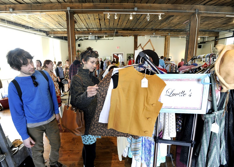 Shoppers browse at the Flea for All market in Portland on April 14. On Monday night, the City Council reduced the licensing fee for flea market operators to $225 a year, from $50 a day, and reduced the annual fee for individual sellers to $20, by eliminating a $35 administrative fee.