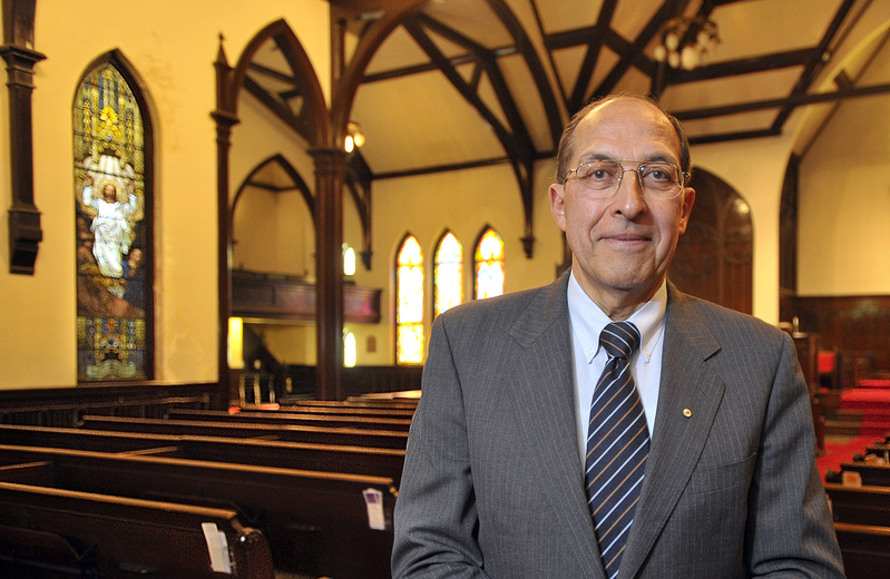 Frank Monsour, new owner of the Williston-West Church in Portland, stands in the sanctuary.