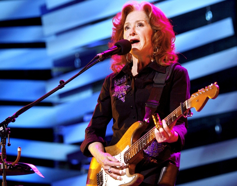 "Bonnie Raitt performs during a sold-out concert at the Merrill Auditorium in Portland on Thursday night. Raitt released her 19th album, ""Slipstream,"" last month."