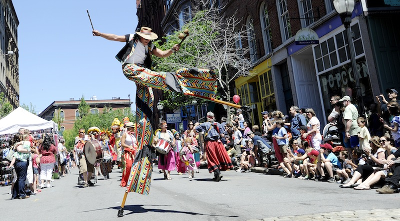 Greg Frangoulis of Shoestring Theater marches down Exchange Street on stilts during the parade that marks the start of the festival.