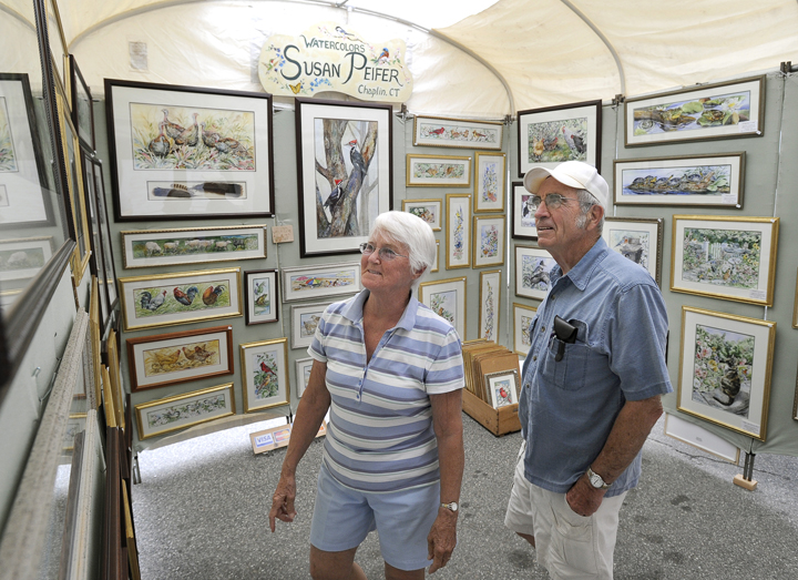 Joanne and Dan Allen of Saco view art on display today as part of a sidewalk art show highlighting Saco's 250th Anniversary Celebration.