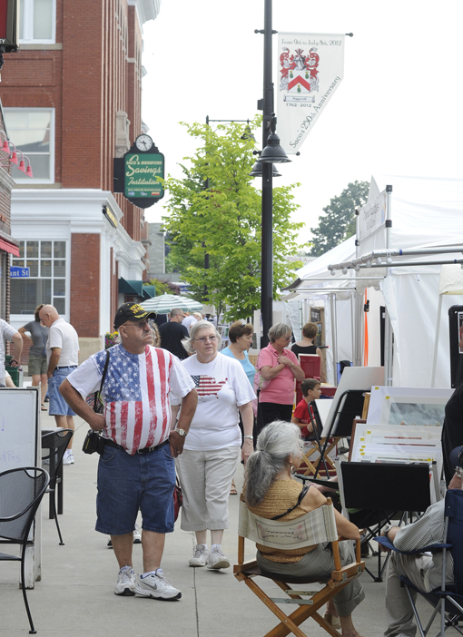 Conrad and Elaine Letellier of Biddeford look at artwork today in Saco.