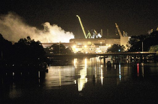 Smoke rises from a dry dock as fire crews respond Wednesday, May 23, 2012 to a fire on the USS Miami SSN 755 submarine at the Portsmouth Naval Shipyard on an island in Kittery, Maine. Four people were injured. (AP Photo/The Herald, Ionna Raptis)