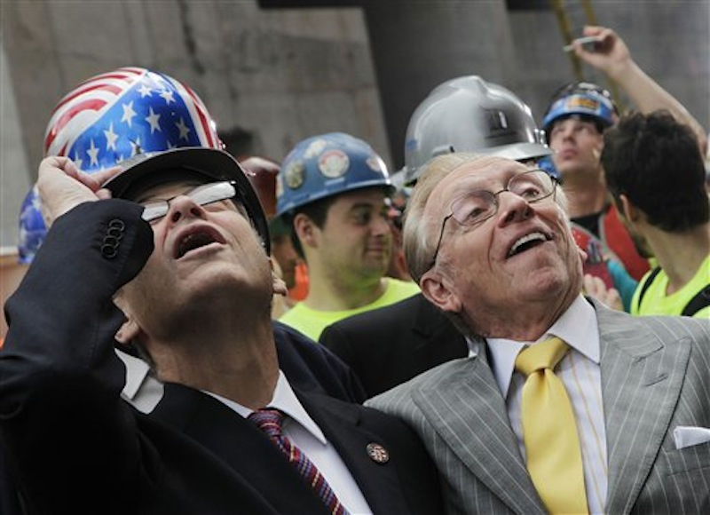 New York State Assembly Speaker Sheldon Silver, left, and developer Larry Silverstein watch as the ceremonial last beam is hoisted to the top of Four World Trade Center, Monday, June 25, 2012.. The 72-floor, 977-foot tower is scheduled to open late next year. It's expected to be the first tower completed on the 16-acre site since the 9/11 attacks. (AP Photo/Mark Lennihan) Silverstein;9/11;Sept 11;ground zero