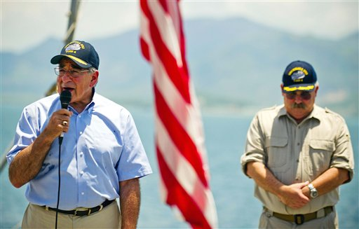 U.S. Secretary of Defense Leon Panetta, left, stands near USNS Richard E. Byrd Ship Master Captain John Sargent as he speaks to the crew aboard the cargo ship in Cam Ranh Bay, Vietnam, Sunday, June 3, 2012. Panetta visited the former U.S. air and naval base in the bay, becoming the most senior American official to go there since the war ended. (AP Photo/Jim Watson, Pool) HORIZONTAL
