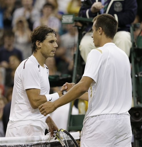 Lukas Rosol, right, of the Czech Republic is congratulated by Rafael Nadal of Spain after Rosol defeated Nadal in a second round men's singles match at the All England Lawn Tennis Championships at Wimbledon. The Associated Press photo