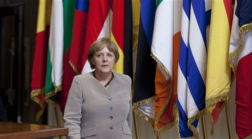 German Chancellor Angela Merkel leaves an EU Summit in Brussels on today. European leaders have agreed to use the continent's permanent bailout fund to recapitalize struggling banks, and agreed to the idea of a tighter union in the long term.