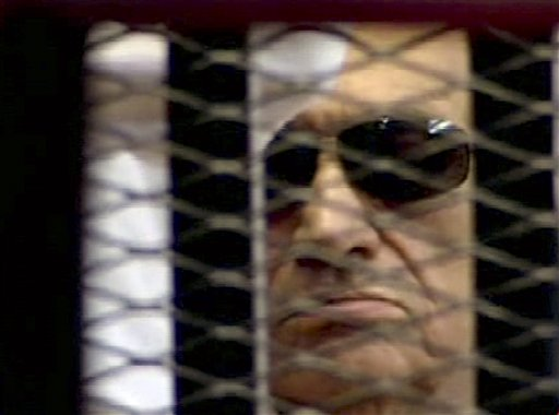 In this video image taken from Egyptian State Television, 84-year-old former Egyptian president Hosni Mubarak is seen in the defendant's cage as a judge reads the verdict on charges of complicity in the killing of protesters during last year's uprising that forced him from power.