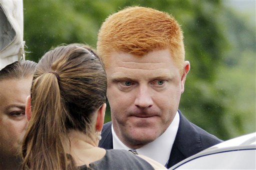 Former Penn State University assistant football coach Mike McQueary, a key witness in the trial of Jerry Sandusky, arrives at the Centre County Courthouse in Bellefonte, Pa., in this June 12 photo.