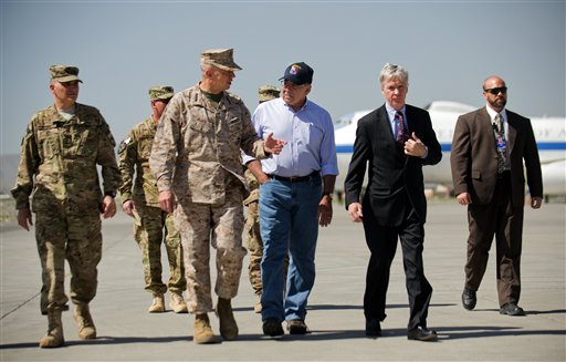 U.S. Defense Secretary Leon Panetta, center right, speaks with U.S. Ambassador to Afghanistan Ryan Crocker, second right, and the head of NATO coalition forces in Afghanistan Gen. John Allen, center left, upon his arrival at Kabul International Airport in Kabul, Afghanistan today.