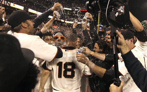 San Francisco Giants pitcher Matt Cain (18) celebrates with teammates after throwing a perfect game in a baseball game against the Houston Astros in San Francisco on Wednesday.