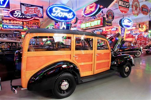 A 1940 Standard Station Wagon is among about 50 vintage cars, many from the 1930s and '40s, and numerous neon, porcelain and tin signs from a bygone era up for auction this weekend.