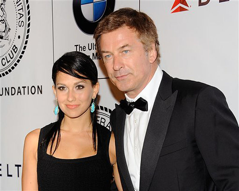 "This June 12, 2012 file photo shows actor Alec Baldwin and his fiancee Hilaria Thomas at The Friars Club and Friars Foundation Honor of Tom Cruise at The Waldorf-Astoria in New York. A New York City news photographer says he was punched by Alec Baldwin outside a marriage license bureau in Manhattan. The Daily News reports that Marcus Santos was snapping images of the ""30 Rock"" star with his fiancÈe Hilaria Thomas Tuesday, June 19. Santos told the paper that Baldwin grabbed a second news photographer, then started shoving Santos and hit him in the chin. He then walked away. Photos on the newspaper's website appear to show Baldwin shoving the photographer. No police report has been filed. A call to the newspaper's public relations office wasn't returned. (Photo by Evan Agostini/Invision/AP, file) Half-Length"