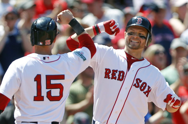 Cody Ross, right, celebrates his three-run home run with Dustin Pedroia (15) in the fourth inning against the Atlanta Braves Sunday in Boston. Ross hit a two-run homer in the fifth, and the Red Sox won, 9-4.