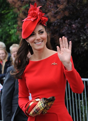 Britain's Kate, Duchess of Cambridge, prepares to board the royal barge as she and Prince William joined the Queen for the Diamond Jubilee Pageant on the River Thames in London today.