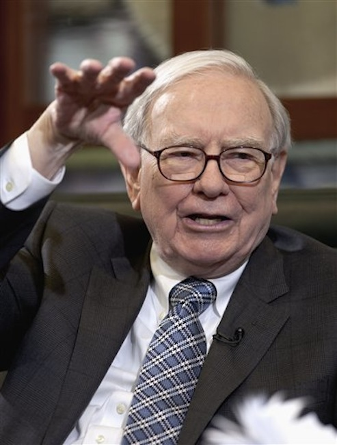 In this file photo from May 7 2012, Warren Buffett, chairman and CEO of Berkshire Hathaway, gestures in Omaha, Neb. The cost to dine with investor Warren Buffett has apparently spiked in value, with one deep-pocketed bidder forking over nearly $3.5 million during a charity auction Friday night June 8, 2012. (AP Photo/Nati Harnik)