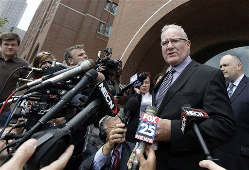 Defense attorney Kevin Reddington speaks to media outside federal court in Boston Tuesday, June 12, 2012, after Catherine Greig, who spent 16 years on the run with former Boston mobster James