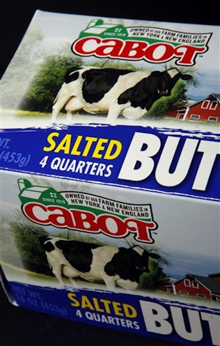 "The new Cabot logo is displayed on a package of butter on Tuesday, June 26, 2012 in Montpelier, Vt. Cabot Creamery Cooperative, maker of cheese, butter and other dairy products, is phasing out labels with the state on the logo. A green outline of the state is being dropped in favor of a green barn and the words ""Owned by our Farm Families in New York & New England."" (AP Photo/Toby Talbot)"
