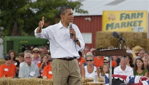 President Barack Obama speaks during a town hall meeting at Country Corner Farm Market in Alpha, Ill. He doesn't hesitate to remind people that his mother grew up in Kansas.