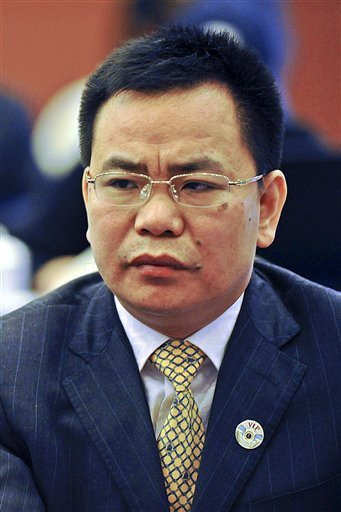 Businessman Lin Chunping attends a press conference in Wenzhou, in eastern China's Zhejiang province. In China, awash with fake iPhones, pirated DVDs of Hollywood blockbusters and knockoff Louis Vuitton bags, 41-year-old rice trader Lin took fakery to a whole new level: He invented a U.S. bank and claimed he bought it.