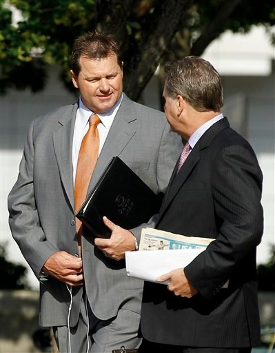 Former Major League Baseball pitcher Roger Clemens, left, arrives at federal court for his perjury trial today in Washington.