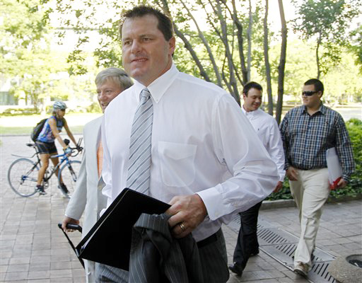 Former Major League Baseball pitcher Roger Clemens, accompanied by his attorney Rusty Hardin, left, arrives at federal court in Washington today.