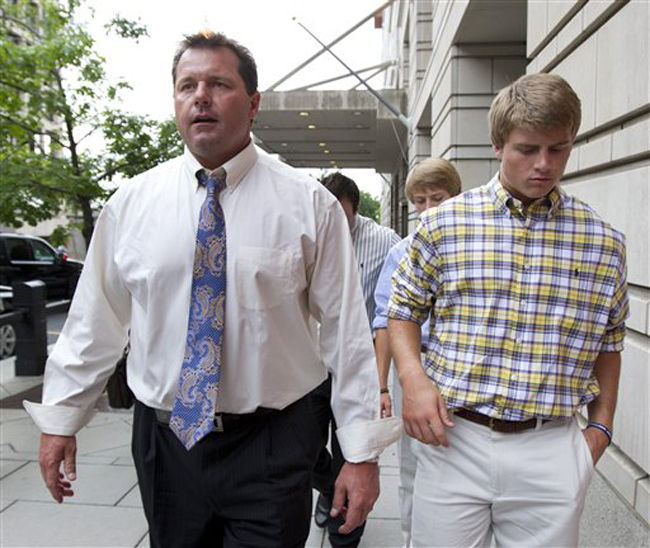 Former Major League Baseball pitcher Roger Clemens, left, leaves federal court in Washington with son Kacy, right, Tuesday, June 12, 2012. A jury has found Clemens not guilty on all charges. (AP Photo/Manuel Balce Ceneta)