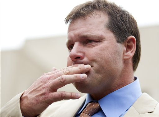 Former Major League Baseball pitcher Roger Clemens holds back tears as he talks to the media outside federal court in Washington on Monday, after his acquittal on charges of lying to Congress in 2008.