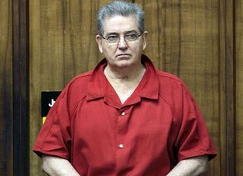 John Connolly stands after a hearing Thursday, Sept. 4, 2008 in Miami. Connolly says White Bulger has told police he wasn't involved in the murder of John Callahan, for which he was convicted. (AP File Photo)