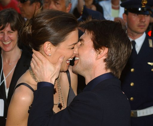 In this Friday April 29, 2005 file photo,Tom Cruise, right, and Katie Holmes laugh as they on Via della Conciliazione Boulevard near St. Peter's Basilica, as they arrive at the St. Cecilia auditorium for the David di Donatello Italian film awards, in Rome. Holmes' attorney Jonathan Wolfe said Friday June 29, 2012 that the couple is divorcing, but called it a private matter for the family. (AP Photo/Corrado Giambalvo, File)
