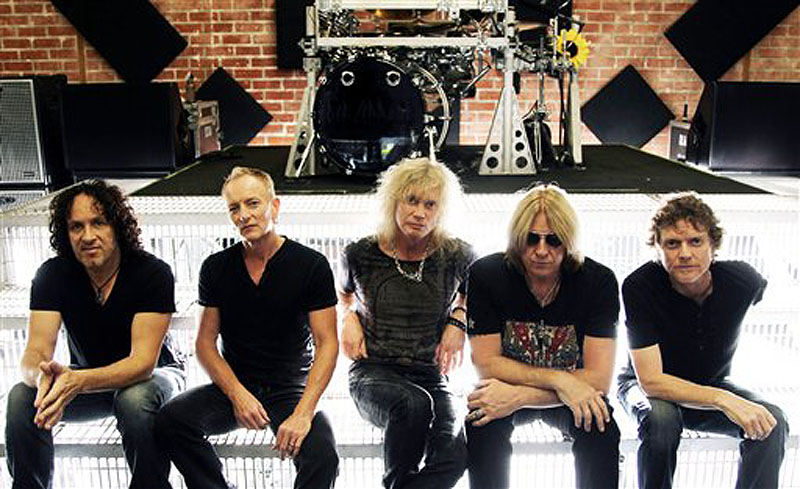 This May 31, 2012 photo shows, from left, Vivian Campbell, Phil Collen, Rick Savage, Joe Elliott, and Rick Allen, of musical group Def Leppard in Los Angeles. The band re-recorded two of their songs that appear in the film,