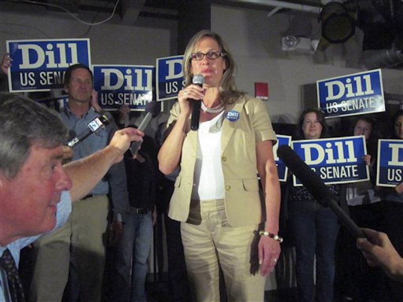 "In this June 12, 2012 photo, Maine Sen. Cynthia Dill claims victory in the race for the Democratic nomination to run for the U.S. Senate, at a Democratic ""Victory Party"" at Bayside Bowl in Portland, Maine. Dill says thereís nothing to lose for standing up for what you believe when youíre the underdog. And sheís still an underdog in the U.S. Senate race, even after winning a decisive victory in the four-way Democratic primary. (AP Photo/The Bangor Daily News, Christopher Cousins)"