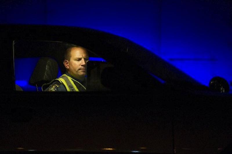 In this December 15, 2011 file photo, Maine State Police Trooper Doug Cropper writes an accident report inside his cruiser on I-295. Cropper ised his cruiser to keep a wrong-way driver from getting onto Tukey's Bridge on Friday afternoon, June 29, 2012.