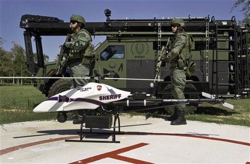 This September 2011 photo provided by Vanguard Defense Industries shows a ShadowHawk drone with Montgomery County, Texas, SWAT team members.