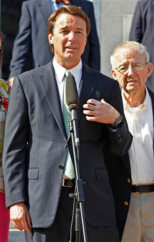 Ex-presidential candidate John Edwards speaks outside a federal courthouse as his father, Wallace Edwards, right, listen after his campaign finance fraud case ended in a mistrial May 31 in Greensboro, N.C. Jurors acquitted Edwards on one charge and deadlocked on the other five, unable to decide whether he used money from two wealthy donors to hide his pregnant mistress while he ran for president and his wife was dying of cancer.