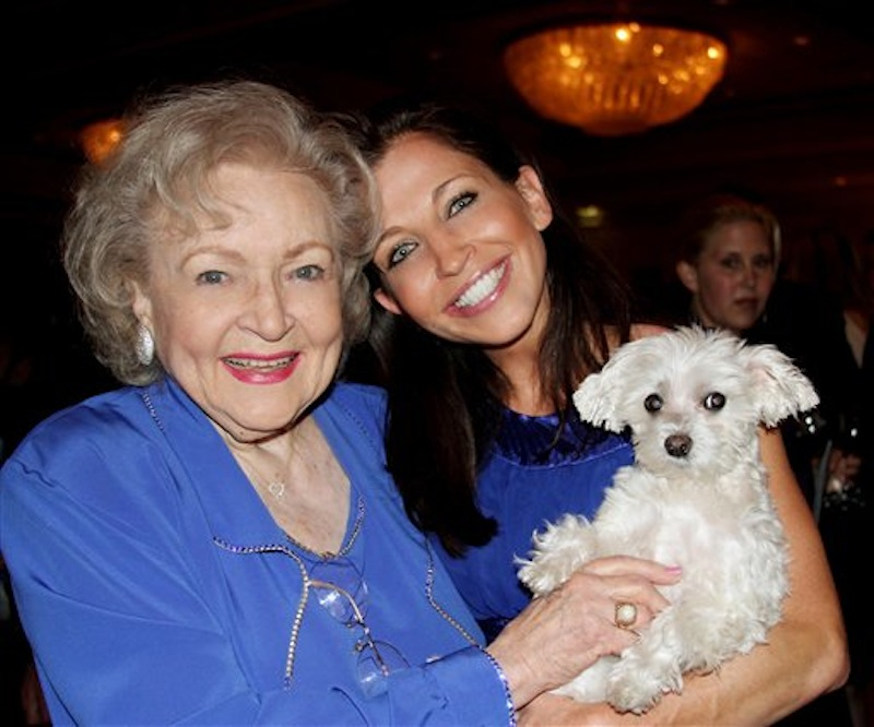 In this undated photo provided by Lucky Diamond Productions, Inc., actresses Betty White, left and Wendy Diamond hold Lucky Diamond. The fifteen-year-old Maltese who the Guinness Book of World Records credited was