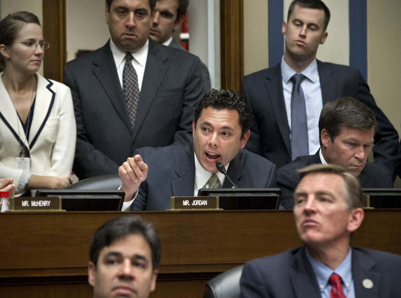 Rep. Jason Chaffetz, R-Utah, center, debates Rep. Stephen Lynch, D-Mass., Wednesday as the House Oversight and Government Reform Committee considers a vote to hold Attorney General Eric Holder in contempt of Congress.