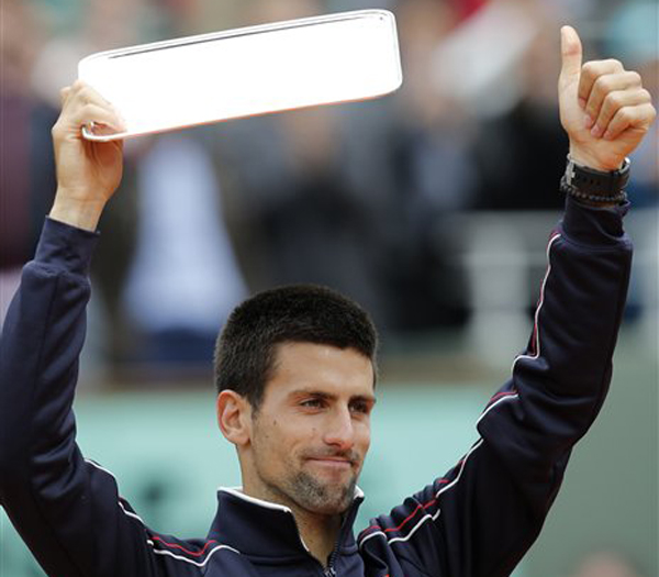 Novak Djokovic of Serbia holds the second place trophy after losing to Rafael Nadal of Spain at the French Open today.