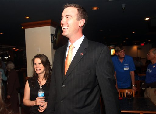 Jesse Kelly, center, Republican candidate for southern Arizona's 8th Congressional District, in an April 17, 2012, photo,