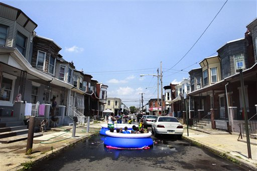 Residents of a Philadelphia neighborhood set up a pool in the street to swim and stay cool on Wednesday. The mercury in Philadelphia rose to 97 degrees, one degree short of the record of 98 set in 1931.