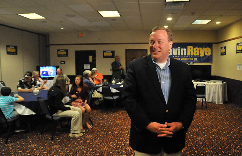 Staff photo by Michael G. Seamans Kevin Raye, candidate for US second congressional district, speaks to media at the Ramada Inn in Bangor Tuesday night.