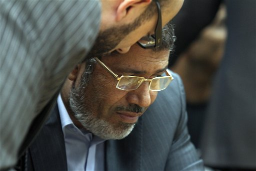 Muslim Brotherhood presidential candidate Mohammed Morsi confers with an aide recently during a meeting with relatives of those killed and injured during last year's revolution.
