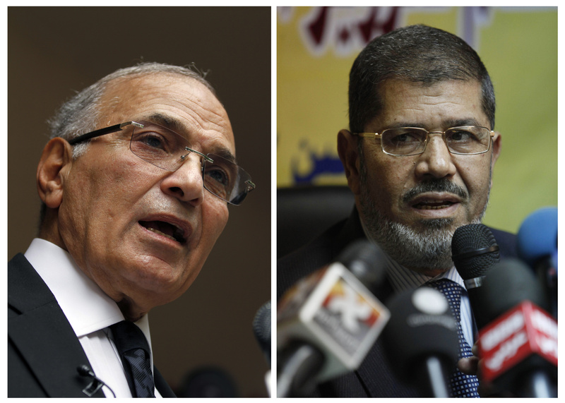 Egyptian presidential candidates Ahmed Shafiq, left, and Mohammed Morsi.